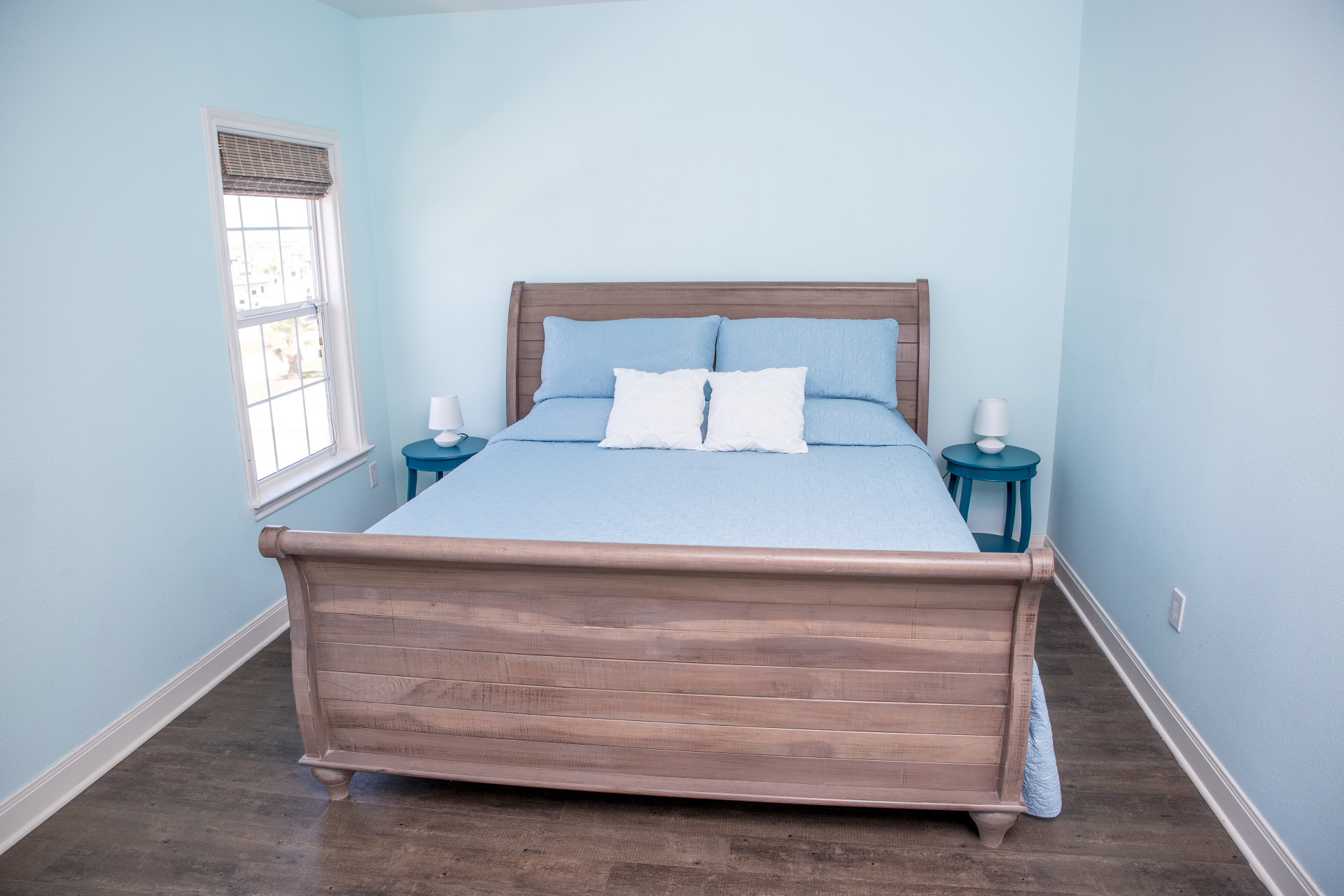 Into the Blue vacation house master bedroom in Galveston RV park
